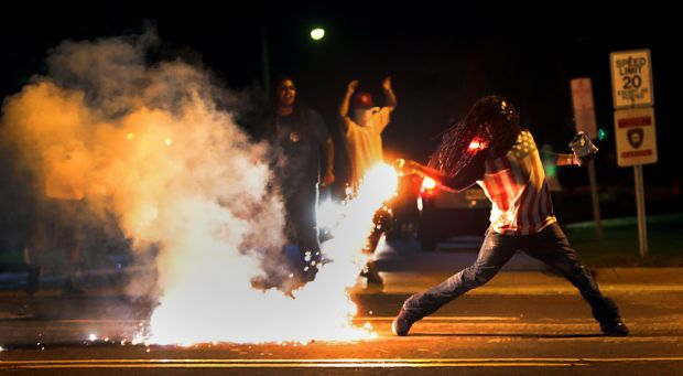 Ferguson police shooting protesters with rubber bullets